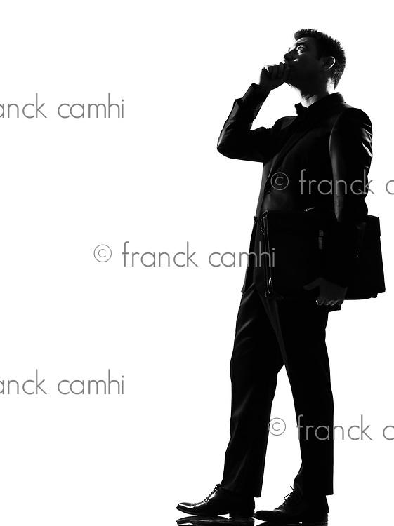 silhouette caucasian business man on the phone expressing behavior full length on studio isolated white background
