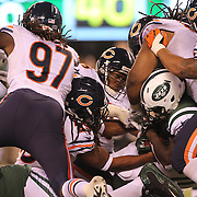 Chris Ivory, New York Jets, is tackled by the Chicago Bears defense during the New York Jets Vs Chicago Bears, NFL regular season game at MetLife Stadium, East Rutherford, NJ, USA. 22nd September 2014. Photo Tim Clayton for the New York Times