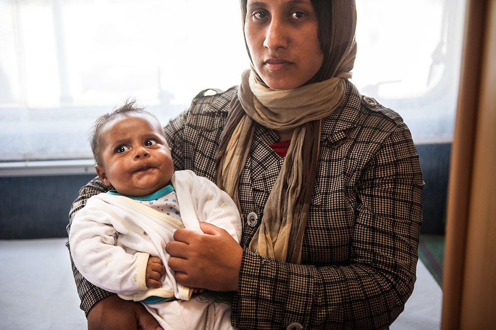 Sheeba from Afghanistan with her 2 month old son waiting to be examined by MSF doctor Anna Hoekstra at the mobile medical centre, a camper van of MSF at Mytiline port, Lesvos, Greece.