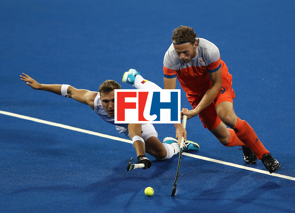 RIO DE JANEIRO, BRAZIL - AUGUST 16:  Bob de Voogd (R) of the Netherlands is challenged by Emmanuel Stockbroekx during the Men's semi final hockey match between Belgium and the Netherlands on Day 11 of the Rio 2016 Olympic Games held at the Olympic Hockey Centre on August 16, 2016 in Rio de Janeiro, Brazil.  (Photo by David Rogers/Getty Images)