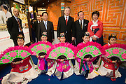 ITB (Internationale Tourismusbörse) 2005, World's largest tourism fair..The Mayor of Berlin, Klaus Wowereit (m., red tie) posing with Korean fan dancers during his opening walk around the fair grounds.