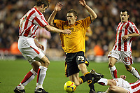 Photo: Rich Eaton.<br /> <br /> Wolverhampton Wanderers v Sunderland. Coca Cola Championship. 24/11/2006. Daniel Jones of Wolves is tackled by the Sunderland defence