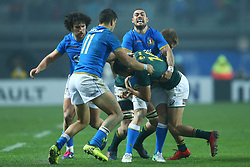 November 25, 2017 - Padova, Italy - Jayden Hayward and Mattia Bellini of Italy tackling on Dillyn Leyds of South Africa at Plebiscito Stadium in Padova, Italy on November 25, 2017, during the Rugby test match between Italy v South Africa. (Credit Image: © Matteo Ciambelli/NurPhoto via ZUMA Press)
