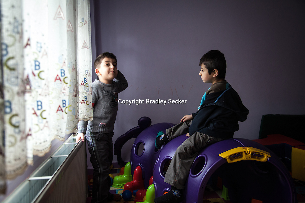 DIYARBAKIR, TURKEY. FEBRUARY 22, 2013 Baran, right, talks with a friend at one of Diyarbakir's few Kurdish language creche's.