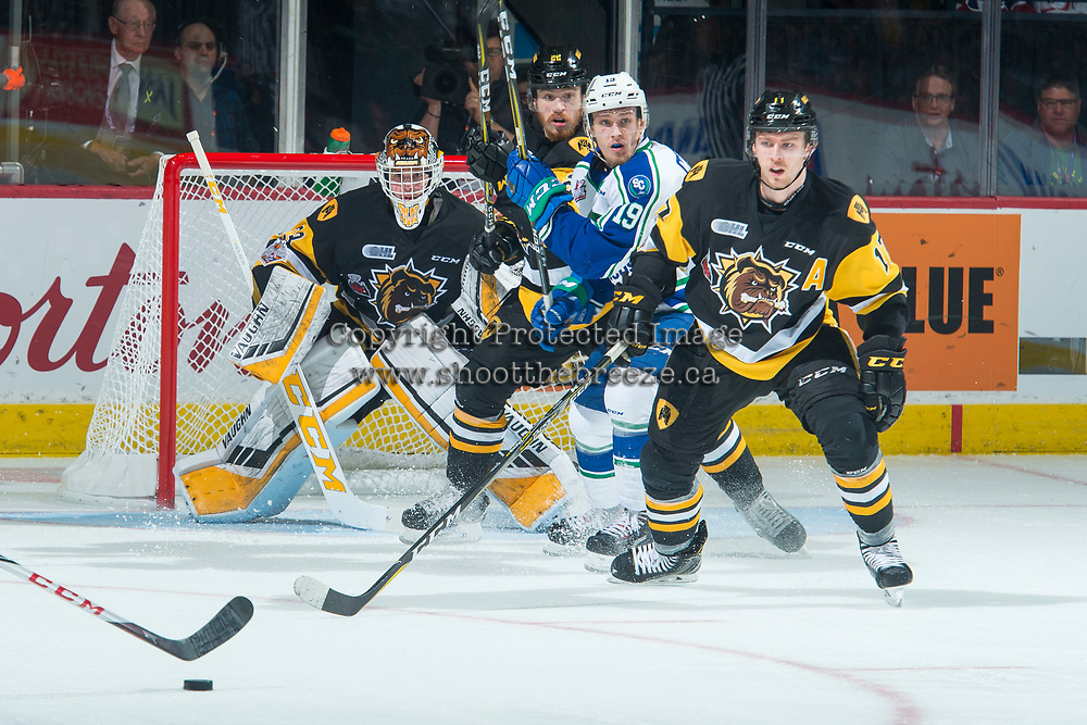 REGINA, SK - MAY 21: Beck Malenstyn #19 of Swift Current Broncos looks for the pass in front of the net of Kaden Fulcher #33, while checked by Brandon Saigeon #17 and Jack Hanley #22 of Hamilton Bulldogs at the Brandt Centre on May 21, 2018 in Regina, Canada. (Photo by Marissa Baecker/CHL Images)