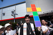 A priest from the Shinjuku Community Church, which does not discriminate against gay people, at Tokyo Rainbow Pride festival, Yoyogi Park, Tokyo, Japan. Sunday April 27th 2014 This was the third year this annual gay-pride event has been held in Japan capital.with food, fashion and health care stalls and musical performances set up in Yoyogi Park event square and a colourful parade around Shibuya at 1pm.