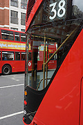 The curved open staircase of London's newest red double-decker Routemaster (27th Feb 2012) bus which is seen in service on the capital's streets for the first time. The hybrid NB4L, or the Borismaster, New Routemaster or Boris Bus, is a 21st century replacement of the iconic Routemaster as a bus built specifically for use in London and is said to be 40 per cent more fuel efficient than conventional diesel buses. The brainchild of London's Conservative mayor Boris Johnson, its funding has been controversial amid massive fare increases in transport.