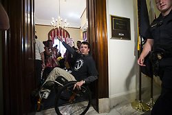 July 19, 2017 - Washington, District Of Columbia, USA - Activist NICK HOLZTHUM of Florida blocks the entrance to Sen. Marco Rubio's (R-FL) office in the Russell Senate Office Building on Capitol Hill as protesters chant inside. The protesters oppose a senate republican effort to repeal and replace the Affordable Care Act also known as Obama Care. (Credit Image: © Alex Edelman via ZUMA Wire)