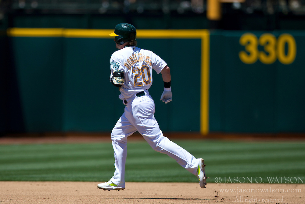 OAKLAND, CA - MAY 26:  Josh Donaldson #20 of the Oakland Athletics rounds the bases after hitting a home run off of Drew Smyly #33 of the Detroit Tigers (not pictured) during the third inning at O.co Coliseum on May 26, 2014 in Oakland, California. The Oakland Athletics defeated the Detroit Tigers 10-0.  (Photo by Jason O. Watson/Getty Images) *** Local Caption *** Josh Donaldson
