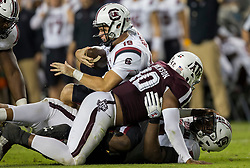South Carolina quarterback Jake Bentley (19) is sacked by Texas A&M defensive lineman Zaycoven Henderson (92) during the fourth quarter of an NCAA college football game Saturday, Sept. 30, 2017, in College Station, Texas. (AP Photo/Sam Craft)