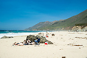 Sunbathers relax on Garrapata Beach, near Carmel-by-the-Sea, along Highway 1, Monterey County, California.