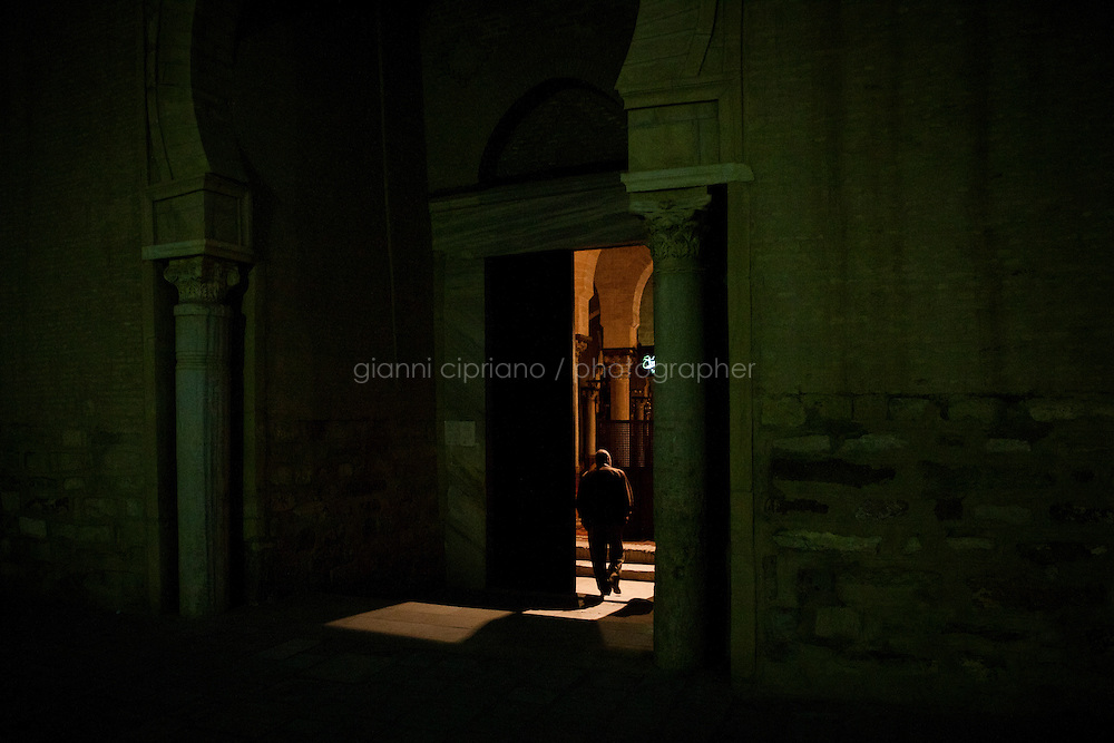 Kairouan, Tunisia - 18 December, 2011: Abdulhamid Alwini, 57, Said Ferjani's lifetime friend since elementary school, enters the Great Mosque of Sidi-Uqba for dawn prayer in Kairouan, Tunisia on 18 December, 2011. Said Ferjani, 54, senior member of the political and communication bureau of the Nahda (Renaissance) party, started his activism in the Negra mosque of his hometown Kairouan when he was 16 years old, debating on politics, philosophy, economy and world events. In 1989 former dictator Zine El Abidine Ben Ali turned against Nahda (or Ennahda) and jailed 25,000 activists. Said Ferjani was jailed and tortured. He then flew Tunisia and moved to the UK. He came back to Tunisia after 22 years, after former dictator Ben Ali flew the country.<br /> <br /> Gianni Cipriano for The New York Times