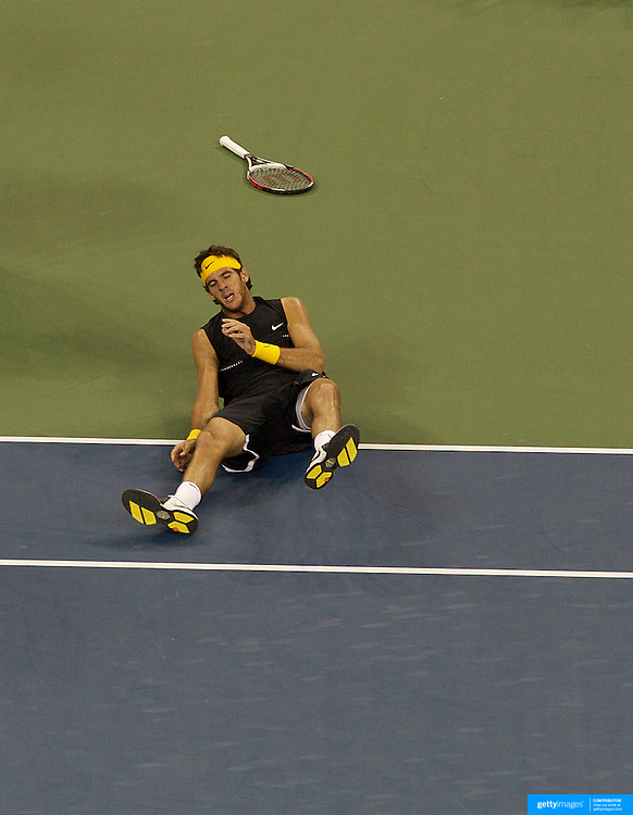 Juan Martin Del Potro, Argentina, falls during his win in the Men's Singles Final against Roger Federer, Switzerland, during the US Open Tennis Tournament at Flushing Meadows, New York, USA, on Monday, September 14, 2009. Photo Tim Clayton.