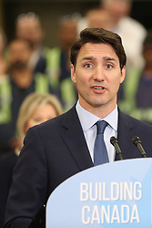 March 21, 2019 - Mississauga, Ontario, Canada - Canadian Prime Minister Justin Trudeau delivers remarks on the 2019 federal budget at a press conference held at a transit maintenance facility on March 21, 2019 in Mississauga, Ontario, Canada. (Credit Image: © Creative Touch Imaging Ltd/NurPhoto via ZUMA Press)