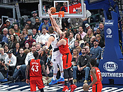 Dallas Mavericks guard Luka Doncic (77) goes up for the shot and is fouled by Toronto Raptors center Marc Gasol (33) while  Pascal Siakam (43) and OG Anunoby (3) await the call during an NBA basketball game, Saturday, Nov. 16, 2019, in Dallas. The Mavericks defeated the Raptors 110-102. (Wayne Gooden/Image of Sport)