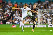 Leeds United midfielder Mateusz Bogusz (44) and Stoke City midfielder Ryan Woods (38) during the EFL Cup match between Leeds United and Stoke City at Elland Road, Leeds, England on 27 August 2019.