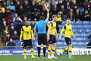 Oxford United defender Rob Dickie (4) shown a yellow card, booked during the EFL Sky Bet League 1 match between Oxford United and Shrewsbury Town at the Kassam Stadium, Oxford, England on 7 December 2019.