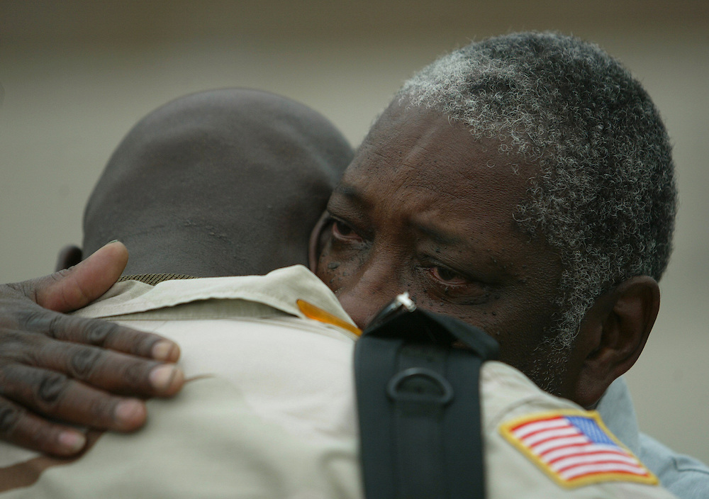 Hurtha Johnson, Sr., right, gives his son Staff Sgt. Hurtha Johnson, Jr., of Torrance, a hug after he returned home to Los Alamitos Army Airfield Saturday April 10, 2004 after spending 14 months in Iraq.