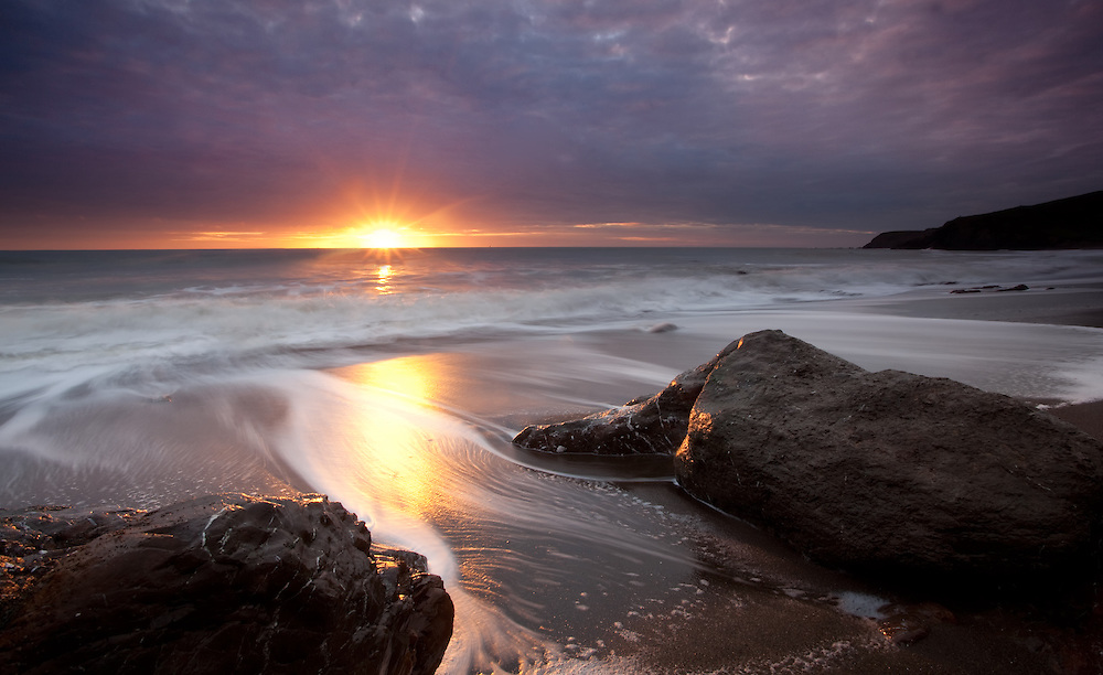 Located in the Marin Headlands, California, Fort Cronkhite is a former World War II military post that stands at the edge of the Pacific Ocean, and this is Rodeo beach which is part of that. Located nearby is the marine mammal center.