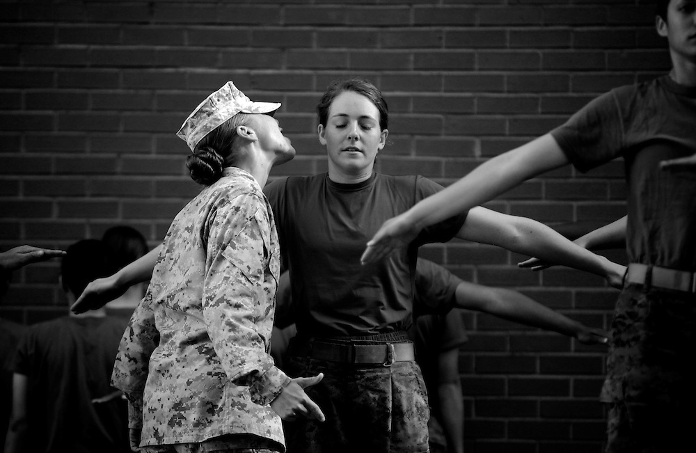Elaine Neal keeps performing intensive training exercises while a drill instructor Sgt. Natalie Cespuglia gets in her face and shouts more instructions during basic training on Parris Island in South Carolina on Sept. 29, 2009. Neal said there were times that she thought about giving up, but knowing she had only a short time before she graduated from boot camp, helped her make it through. Greg Kahn/Staff