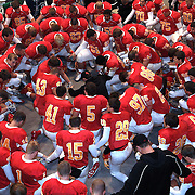 Players and their coach huddle for a pregame prayer at Simpson College in Indianola, Iowa.