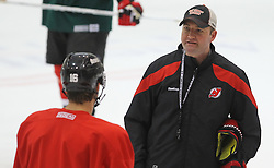 May 29; Newark, NJ, USA; New Jersey Devils head coach Peter DeBoer talks to New Jersey Devils center Jacob Josefson (16) during Stanley Cup Finals media practice day at the Prudential Center.