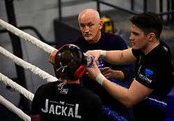 © London News Pictures. 29/12/2016. Two-weight world boxing champion, Carl Frampton (front), nickname The Jackal, sparring at his gym in south London. Pictured with his manager Barry McGuigan (top, centre) and trainer Shane McGuigan. Frampton has been named ESPN's fighter of the year. Photo credit: Ben Cawthra/LNP