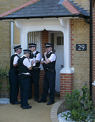 Three children found dead in south London house. Police officers stand in front of the house where three children were found Tuesday night. Thetford Road, New Malden, South London, London, United Kingdom. Wednesday, 23rd April 2014. Picture by Daniel Leal-Olivas / i-Images