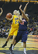 February 24 2011: Iowa Hawkeyes guard Jaime Printy (24) puts up a shot as Illinois Fighting Illini guard Amber Moore (42) defends during the first half of an NCAA women's college basketball game at Carver-Hawkeye Arena in Iowa City, Iowa on February 24, 2011. Iowa defeated Illinois 83-64.