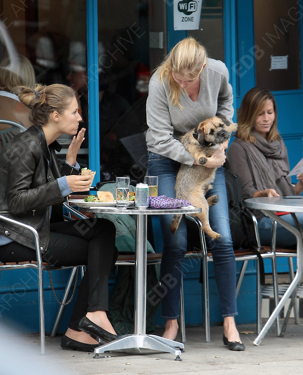 21.SEPTEMBER.2012. LONDON<br /> <br /> LARA STONE AND FRIEND HAVE A BITE TO EAT IN PRIMROSE HILL AT A CAFE NINE BEFORE BERT THE DOG DOES A WOOPSEY IN FRONT OF A BREAD STORE AND LEAVING THE SHOP ASSISTANT TO CLEAN IT UP.<br /> <br /> BYLINE: EDBIMAGEARCHIVE.CO.UK<br /> <br /> *THIS IMAGE IS STRICTLY FOR UK NEWSPAPERS AND MAGAZINES ONLY*<br /> *FOR WORLD WIDE SALES AND WEB USE PLEASE CONTACT EDBIMAGEARCHIVE - 0208 954 5968*