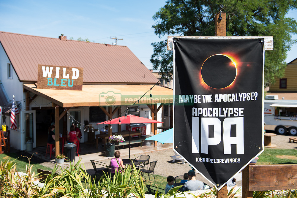 A sign is seen along the roads in Madras, Oregon, where thousands of visitors are expected for the total solar eclipse, Saturday, Aug. 19, 2017. The eclipse will be sweeping across a narrow portion of the contiguous United States from Lincoln Beach, Oregon to Charleston, South Carolina on August 21, 2017. A partial solar eclipse ill be visible across the entire North American continent along with parts of South America, Africa, and Europe.  Photo Credit: (NASA/Aubrey Gemignani)