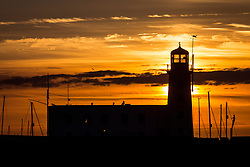 © Licensed to London News Pictures. 25/03/2018. Scarborough UK. Picture shows Scarborough light house at sunrise this morning on the Yorkshire coast. Photo credit: Andrew McCaren/LNP