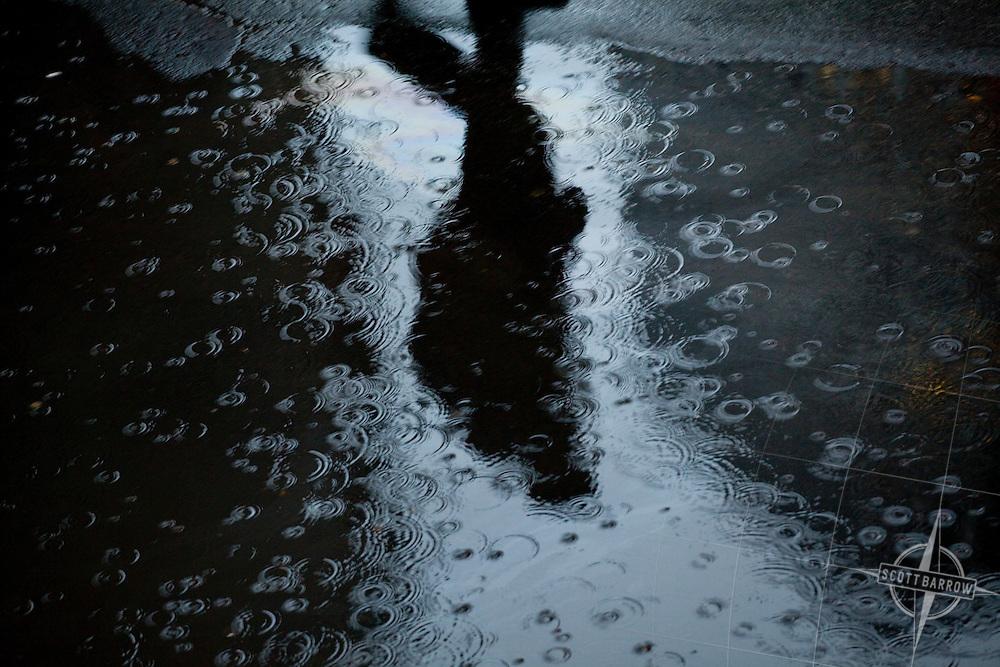 Pedestrians walking in rainy New York City.
