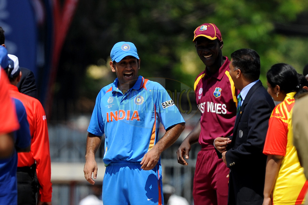 Mahendra Singh Dhoni captain of India and Darren Sammy captain of West Indies during the ICC Cricket World Cup match between India and West Indies held at the  MA Chidambaram Cricket Stadium in Chennai on the 20 March 2011..Photo by Pal Pillai/BCCI/SPORTZPICS