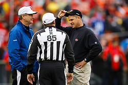 Jan 22, 2012; San Francisco, CA, USA; San Francisco 49ers head coach Jim Harbaugh (right) talks to NFL referee Ed Hochuli (85) before the 2011 NFC Championship game against the New York Giants at Candlestick Park.  Mandatory Credit: Jason O. Watson-US PRESSWIRE