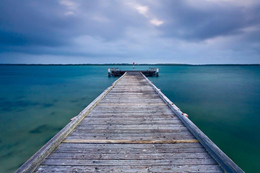 Military Jetty's worn wooden planks lead you into the aquamarine waters of the pumicestone passage.
