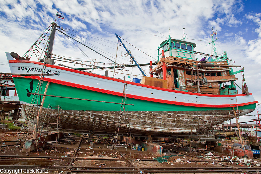 Sept. 24, 2009 -- PATTANI, THAILAND: A fishing boat being rebuilt in Siriudom Shipyards in Pattani, Thailand. Fishing is the main industry in Pattani, one of just three Thai provinces with a Muslim majority. Thousands of people, mostly Buddhist Thais and Burmese Buddhist immigrants, are employed in the fishing industry, either crewing ships, working in processing plants or working in the ship building and refreshing yards.   Photo By Jack Kurtz / ZUMA Press