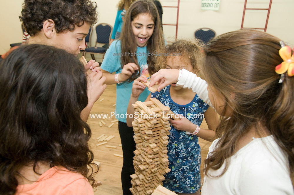 Group of children building with wooden blocks