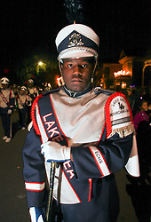 12 Feb 2015. New Orleans, Louisiana.<br /> Mardi Gras. A member of a marching band  makes his way along Magazine Street  with the The Krewe of Muses. <br /> Photo; Charlie Varley/varleypix.com