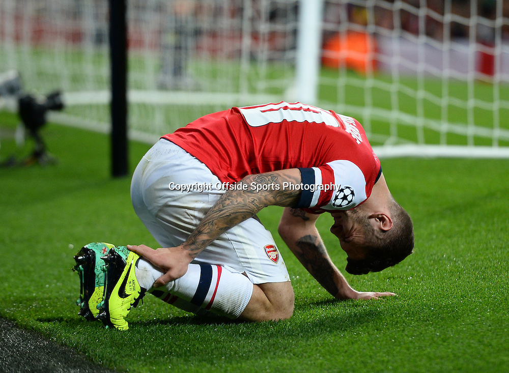 21st October 2013 - UEFA Champions League Group F - Arsenal v Borussia Dortmund - Jack Wilshere of Arsenal reacts after he injures himself trying to reach the ball ahead of Roman Weidenfeller of Borussia Dortmund - Photo: Marc Atkins / Offside.