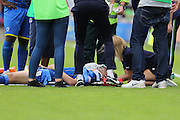 Connor Smith defender for AFC Wimbledon (18) receives treatment on the pitch during the Sky Bet League 2 match between AFC Wimbledon and Newport County at the Cherry Red Records Stadium, Kingston, England on 7 May 2016. Photo by Stuart Butcher.