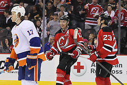 Mar 8; Newark, NJ, USA; New Jersey Devils left wing Ilya Kovalchuk (17) and New Jersey Devils right wing David Clarkson (23) celebrate Kovalchuk's goal during the second period at the Prudential Center.