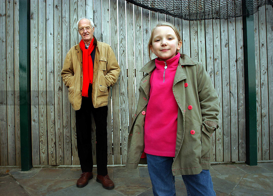 Picture by Matt Gore/icon photos....11th December 2004........<br /> Michael Frayn playwright with his 8 year old Grandaughter Eliza Frayn who has written her first Play. Acton, London