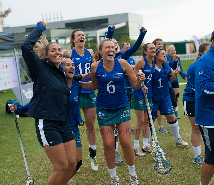 Scotland's players and staff celebrate winning against Israel during their classification game at the 2017 FIL Rathbones Women's Lacrosse World Cup, at Surrey Sports Park, Guildford, Surrey, UK, 21st July 2017.