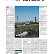 "Tearsheet of ""Ukraine: um dia a morte cai do ceu"" published in Expresso"