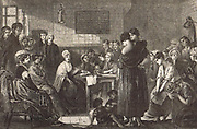 Elizabeth Fry (1780-1845) English Quaker social reformer reading to female prisoners at Newgate. Man on left with hand on back of chair is Thomas Fowell Buxton (1786-1845)
