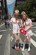 Two male cross-dressers wear women's nurses's costumes.