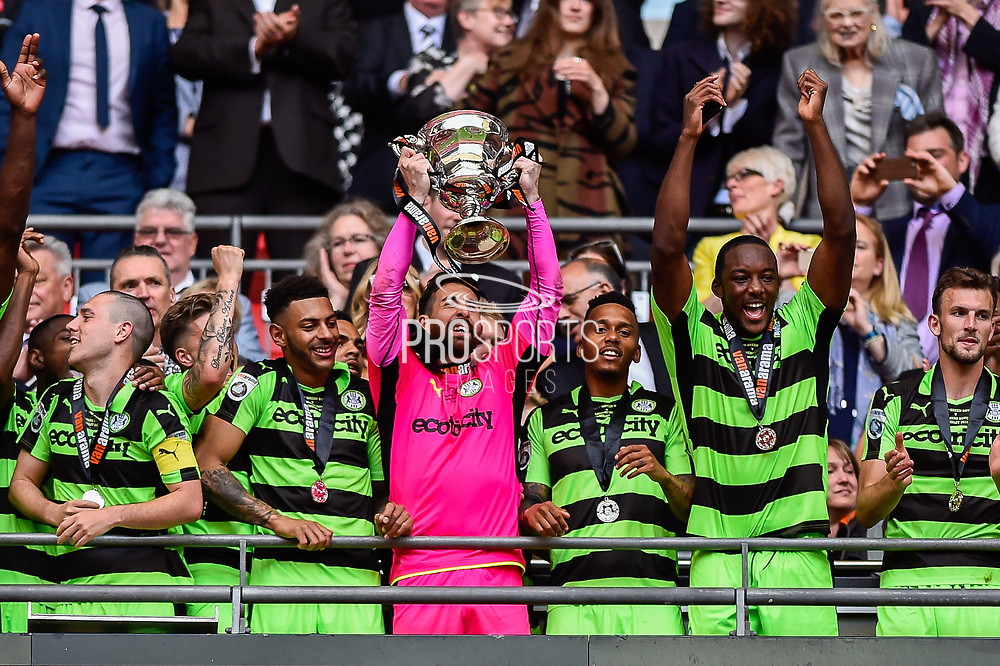 Forest Green Rovers lift the ply off final trophy and celebrate promotion in to the football league Forest Green Rovers goalkeeper Sam Russell(23) during the Vanarama National League Play Off Final match between Tranmere Rovers and Forest Green Rovers at Wembley Stadium, London, England on 14 May 2017. Photo by Adam Rivers.
