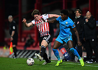 Football - 2018 / 2019 Emirates FA Cup - Fourth Round, Replay: Brentford vs. Barnet<br /> <br /> Barnet's Ephron Mason-Clark holds off the challenge from Brentford's Mads Bech Sorensen, at Griffin Park.<br /> <br /> COLORSPORT/ASHLEY WESTERN
