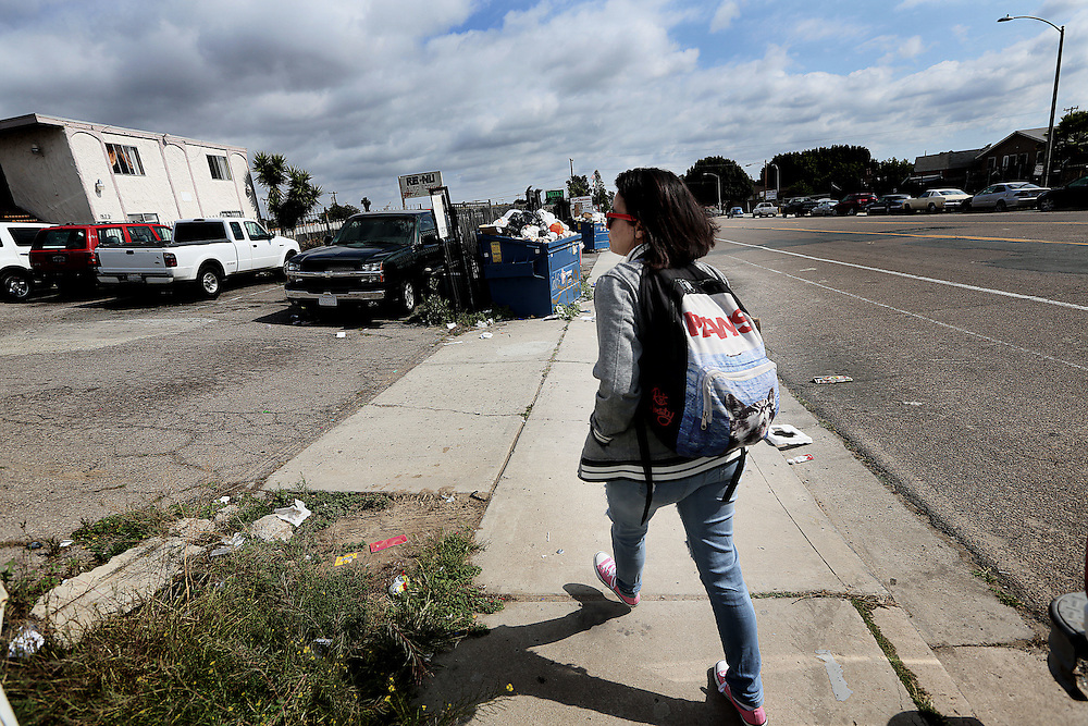 Andrea Chacon, A Senior at The Monarch School, walks  home from the Trolley stop after a day at school in San Diego, CA on Monday, May 18, 2015.  The Monarch School is the largest elementary through High School facility that caters to students that are homeless or are have associations with homelessness.(Photo by Sandy Huffaker for The Atlantic)